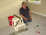 Dad finishing off the laying of the carpet.JPG